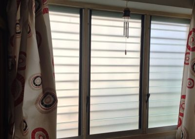 Breezway Louvres with silkscreen glass provide privacy for the bedroom